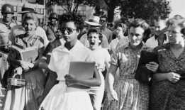 06 Sep 1957, Little Rock, Arkansas, USA --- Elizabeth Eckford ignores the hostile screams and stares of fellow students on her first day of school.  She was one of the nine negro students whose integration into Little Rock's Central High School was ordered by a Federal Court following legal action by NAACP. --- Image by © Bettmann/CORBIS